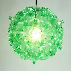 Bubble Chandelier by Souda is made from post-consumer PET bottles collected by the homeless in New York City. Portion of proceeds donated to Sure We Can.