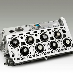 """Unique and eye-catching, this watch winder for 16 timepieces, it`s based on a BUGATTI """"Veyron"""" engine block developed in Germany by ORIGINTIMES."""