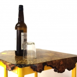 The first in a new series of furniture by sculptor and designer Joshua Bennett. This end table features a maple burl top wrapped around a bright yellow geometric steel base.