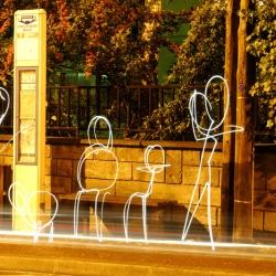 """Bus Stop"" from the series Light is Life showing light characters hand drawn by Christopher Hibbert, french photographer and light painter."