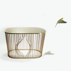 Coffee table Bye-Bye Bird Design by Runa Klock of Frøystad + Klockis. The table is made of brass, inspired by old classic wire furniture, but with a humorous and functional twist!