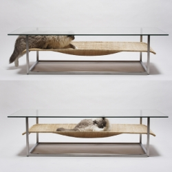 The low slung hammock coffee table designed by Case Real for E&Y of Japan offers a shelf for books, magazines, objets d'art or the occasional cat.