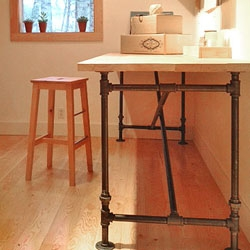 Finally, a free, downloadable plan for a fab, industrial-chic table. DIY plans to build this cast iron table base with butcher block top. Customize to your required size/specs.
