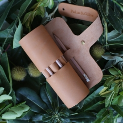 Leather case by the design label  Palm & Olive. Palm & Olive designs uses elements of volume and flatness at the same time. creating small leather goods which are minimalist, clean, direct and functional.
