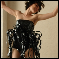 Nice artwork  by Scianca. Dress made with VHS bands.