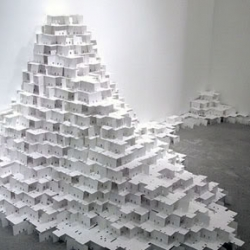 Carte Blanche is an art installation by Jean Shin using masses of blank rolodex cards to hint our life in the age of digital, the social network and our fragile existence.