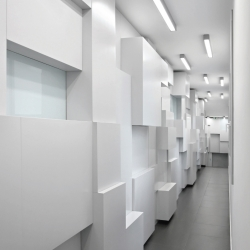 Show-room in Champs-Elysées where corridors were transformed into display areas, by Pascal Grasso Architectures.