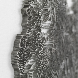 Artist Chen Chun-Hao reproduces traditional Chinese ink landscape paintings using a nail gun and thousands of nails deriving an impressive effect.