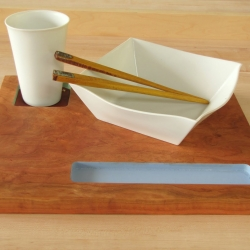 Striking, simple slip-cast porcelain cup and bowl with a cherry wooden platter - both handmade by Mark Warren.