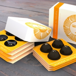 Squeeze box inspired folded paper Chocolate Truffle interactive box, by Design Packaging's Evelio Mattos.