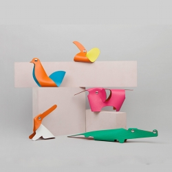 Clickazoo is a colorful collection of foldable leather animals from Hermès, developed by Swiss designer Adrien Rovero Studio.