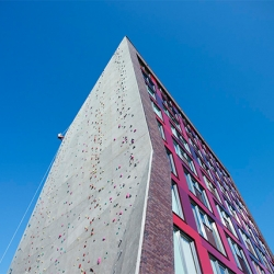 Arons & Gelauff Architects have created this 30 meter building that features a climbing wall with 2500 grips!