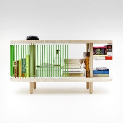 Designed by Cyril de Moulins, Club Sandowich is a base cabinet framed with bungees.