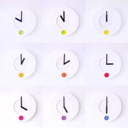 Colour O'Clock by Duncan Shotton for Rainbow Spectrum. As time passes, the colour in the round window continously glides through the full spectrum of colours, creating a more relaxed method of telling the time, not by number, but by colour.