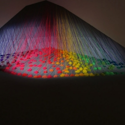 These rainbows are not what they seem. Lee Baker used ten thousand meters of acrylic yarn to create Refractive Monolith, a piece commissioned by The Future Tense.