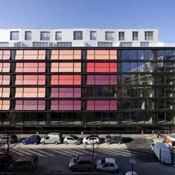 Coral House is a mixed-use building in Geneva, Switzerland, designed by Group8. Eye-catching as it is covered with colorful motorized fabric window blinds.