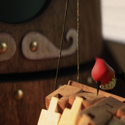 Colosse - A Wood Tale, a short film from director Yves Geleyn about the unlikely friendship between a giant wood robot puppet and a curiously friendly woodpecker.