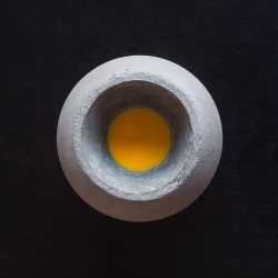 Germán González Garrido designed the CONCRETE BALL LED HANGING LAMP with the intention of embeding large LED COB chips during the casting process. As a result, the lamp is a monolithic concrete piece with no joints.
