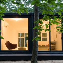 """Another design from container was made by Maziar Behrooz Architecture.  This is an art studio, built near their client's house. The design is very simple, using two 9'-6"""" x 40' x 8' shipping containers."""