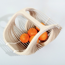 'Corbeilles' is a stunning series of plywood baskets, designed by Pierre Brichet.