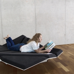 """Cay"", a landscape for your livingroom by Alexander Rehn. The user is the protagonist, through his movement he changes the shape of the furniture. He is free to choose whether he wants to sit, lie down or relax on it with someone else."