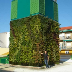 A plant cube in Getafe, Spain is situated above a shopping center to muffle and cool their refrigeration unit. By Paisajismo Urbano (Urban Landscape) the cube will create enough oxygen for 128 people for a whole year.  Read more: World's First Vertical Cube Garden Planted In Spain | Inhabitat - Green Design Will Save the World