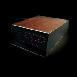 Marc Owen's The Da Vinci Alarm Clock works on a very basic system. The Dot Matrix display will always show either Sleep or Awake.