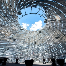 NASA's Orbit Pavilion sculpture, on display at the Intrepid Air, Sea and Space Museum in New York,  creates a visual impression of swirling motion to accompany the movement and sounds of space satellites.