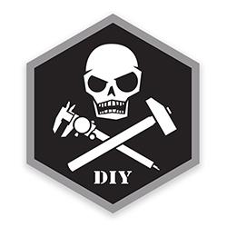 "Prometheus Design Werx DIY Sticker - Memento Mori Skull with crossed caliper, forging hammer and ""DIY"""
