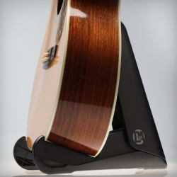 The sleek design of the D&A GIGSTAND Acoustic holds most acoustic guitars, collapses in two simple steps and can be carried in a gig bag or even in the back pocket of your jeans. (There's also an electric version!)