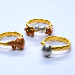 "Part of the ""Elements Series"". Made of pure elements such as gold, silver, copper, aluminum, palladium. When you melt the ring, you will create an 18 karat alloy. So what you are wearing is an 18 karat gold ring, it's just not mixed yet."