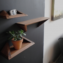 Stealf, beautiful and eye-catching solid wood shelves, with similarities in form to the Stealth bomber, can be mounted either way. By Toronto's urbanproduct.