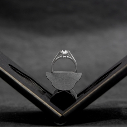 Clifton, flat engagement ring case, with a unique, discreet design, slips easily into a pocket or wallet.