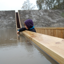 The Moses Bridge by RO & AD in The Netherlands allows people to cross a moat within the water.