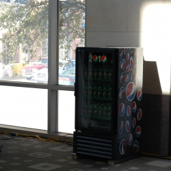 Spotted at SXSW!  Pepsi's new video cooler. It looks like they're using a projector to display video content directly on the door.