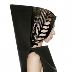 Technogenesis is the latest collection from Kiev-based DZHUS. The laser cut Transforming Neoprene Hood Dress, a unique black dress made with a futuristic combination of dense knitted fabric and matte neoprene.