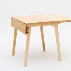 Nathalie Dackelid's expandable table Wooden Cloth is made of solid ash. The table is designed to adapt itself in size to the many different situations through life, prolonging its usefulness.