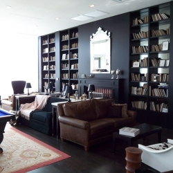 Custom library specialists from Juniper Books created this library for a Dallas Club to add some flair to the design of their actual book collection.