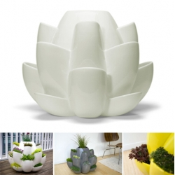 Nature is a modern ceramic planter intended for growing a variety of herbs and flowers. Opening like a blossom, the form allows each pocket to collect water.