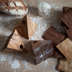 Studiolav Designer Baking gives cookies a taste of high fashion. The Greek designers created a set of solid wood stamps, bearing hounds tooth and tweed patterns, to give sweet pastries a small dose of style.