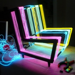 """The """"Disco Chair"""" created by Kiwi & Pom for Wallpaper* Magazine, constructed from 200 linear metres of Electroluminescent wire. The chair transforms into a neon rainbow when powered."""