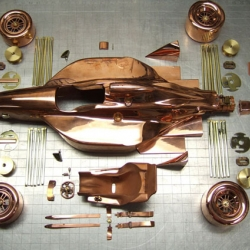 Gorgeous copper 1:12th scale race car models. Handmade with impeccable focus and attention to detail.
