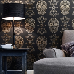 In this unique wallpaper, intricately illustrated Day of the Dead Sugar Skull has been given a sophisticated twist by replicating it in gold on a rich matte dark charcoal, making it a luxurious addition to any interior.