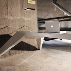 Bulgarian designer Jovo Bozhinovski of Elza design created the dynamic Desk E.L.A. Made from fiberglass, attached with two steel cables to the wall.