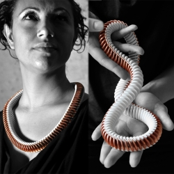 Michiel Cornelissen's E 5.55 project combines 3d-printing and 111 five-eurocent coins to create a stunning necklace.