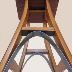 The Eiffel, interpretation of the classic bar stool using only sustainable materials. Entirely made with recycled oak and galvanized steel hoop from discarded French wine barrels.