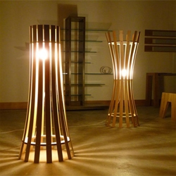 Davin Larkin created the light design Pinch and Splay floor lamps, widened cylindrical form casting light and shadows, built by hand.