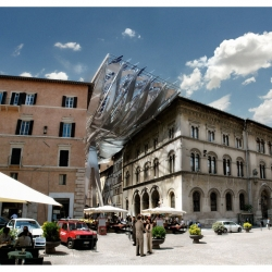 New 'Energy Roof' in Perugia, designed by COOP HIMMELB(L)AU with a goal to generate energy for the city, serving as a canopy along Via Mazzini in the center of Perugia.
