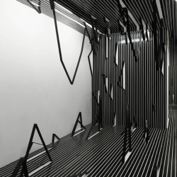 What I don't know about space at Museum 52 sees Esther Stocker transform the gallery into a three dimensional graph with only some cardboard, gaffer tape and sticky back plastic.