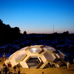 At the Danish Roskilde Music Festival, a temporary plywood dome installation, from architects Kristoffer Tejlgaard.